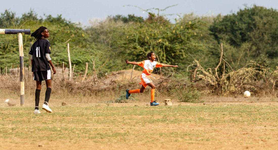 Playing soccer gives these young woman great skills and attributes. These attributes can then be transferred as skills into their personal lives. As young children in Africa look up to their peers, they practice the same attributes. Donate to give children the help they need.